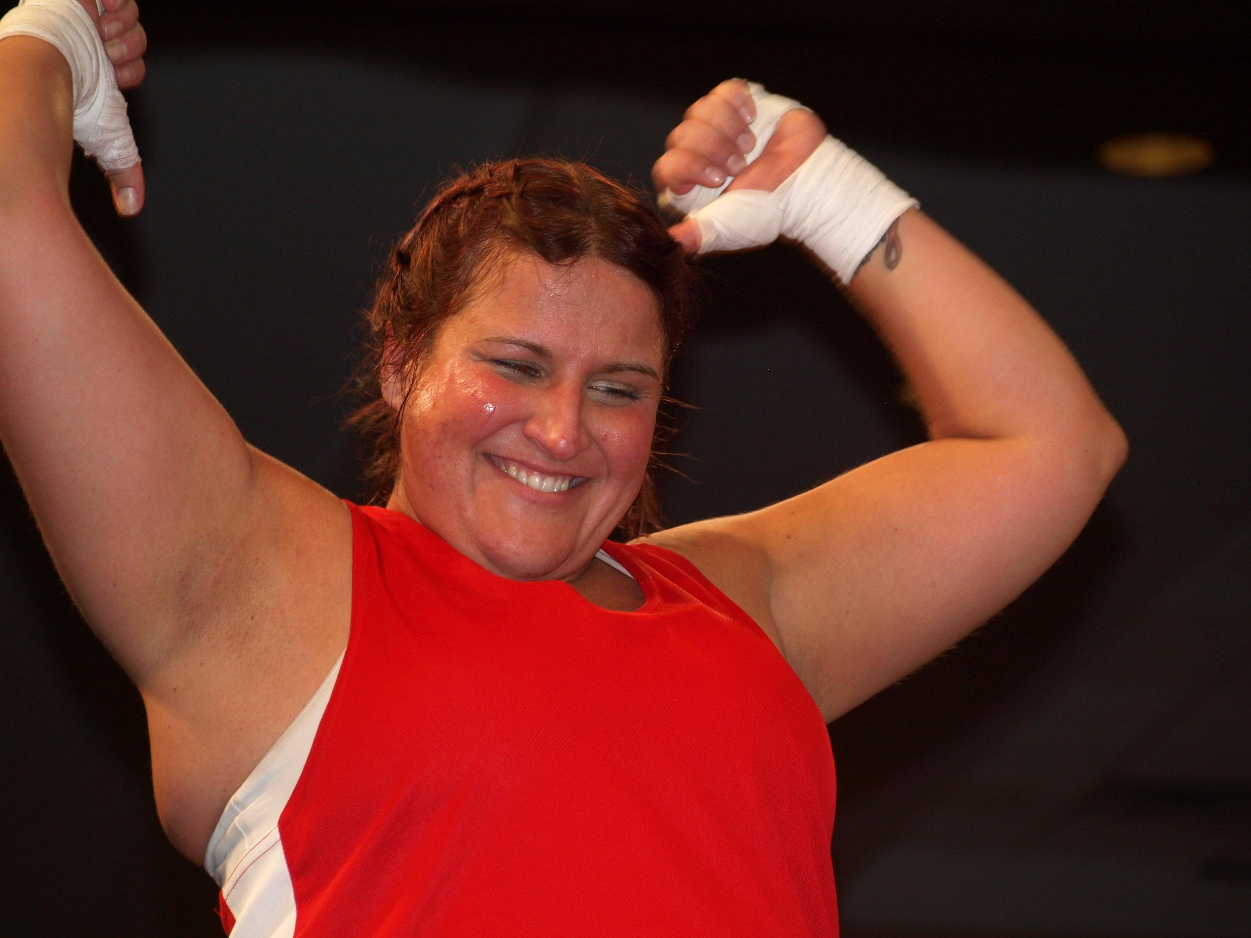 "Boxer Lauren ""The Belmont Brawler"" Powers celebrates.   Long Islander News Photo/Connor Beach"