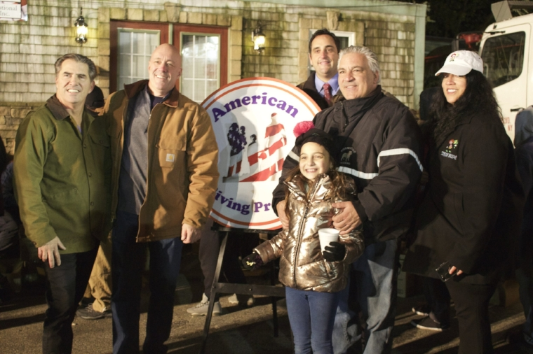 The eighth annual Sorrentino Turkey Drive was a booming success, raising and distributing a record 2,150 turkeys to local families. Pictured, from left, are: Huntington Councilman Eugene Cook; George Schwertl; Huntington Supervisor-elect Chad Lupinacci; Andre Sorrentino, organizer of the event, along with his daughter; and Toys for Hope founder Melissa Doktofsky.   Long Islander News Photo/Janee Law