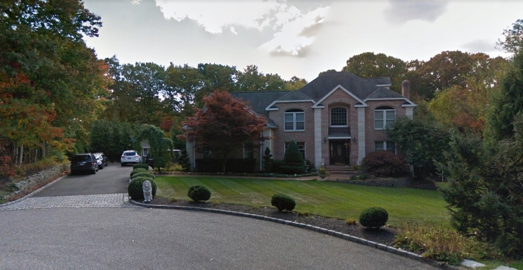 "The Shoreham home where a Northport man died Saturday after the ""ground gave way"" during a cesspool installation, according to Suffolk police.   Photo/Google Maps"