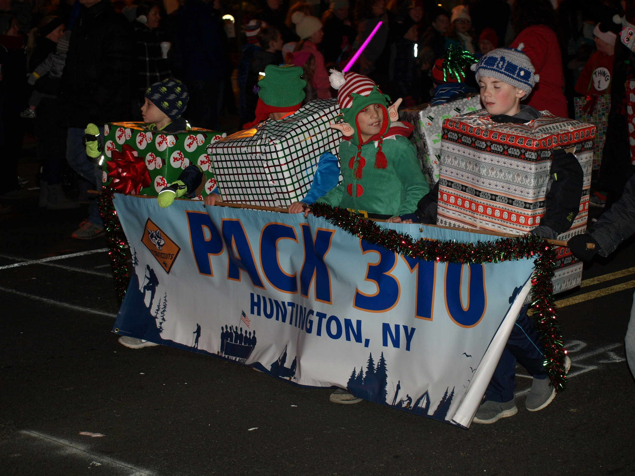 Huntington Cub Scouts Pack 310 marching in the 2017 Huntington Holiday Parade on Sunday night.   Long Islander News Photo/Connor Beach