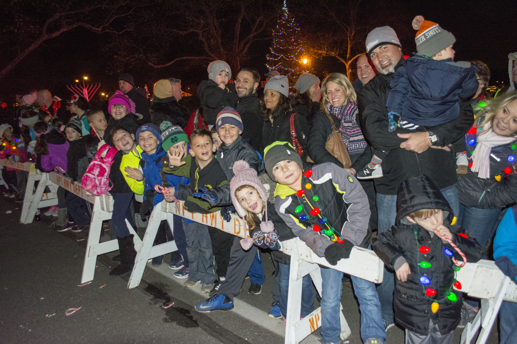 Families lined the streets of Northport to meet Santa Claus and his friends.    Long Islander News Photo/Andrew Wroblewski