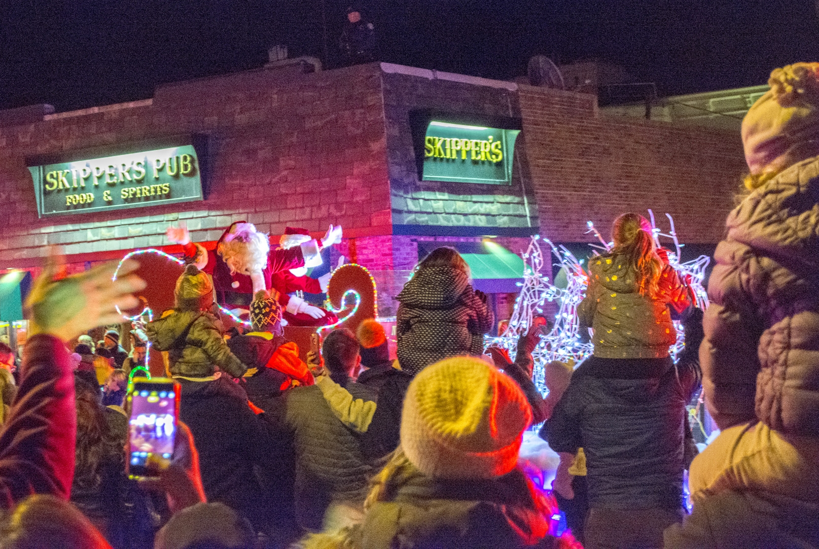Thousands hit the streets to welcome Mr. and Mrs. Claus to Northport Village on Friday.  Long Islander News Photo/Andrew Wroblewski   Long Islander News photos/Andrew Wroblewski
