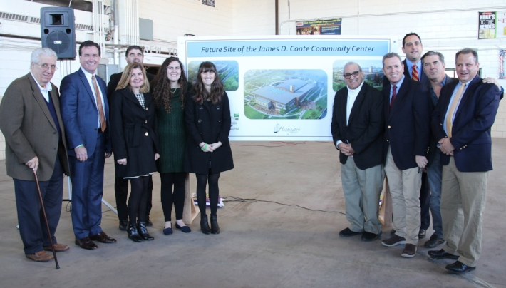 State and town officials, as well as members of the Conte family, unveil plans for what will be the Conte Community Center at the site of the New York State Armory in Huntington Station.   Photo Courtesy of Town of Huntington
