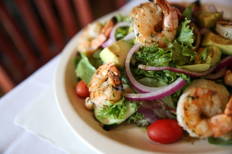 The Shrimp and Avocado Salad from Christopher's unites smoky, grilled shrimp with fresh avocados, dressed up with chickpeas, tomatoes, onions, cucumbers drizzled with a cilantro lime vinaigrette.  Long Islander News Photo/Archives