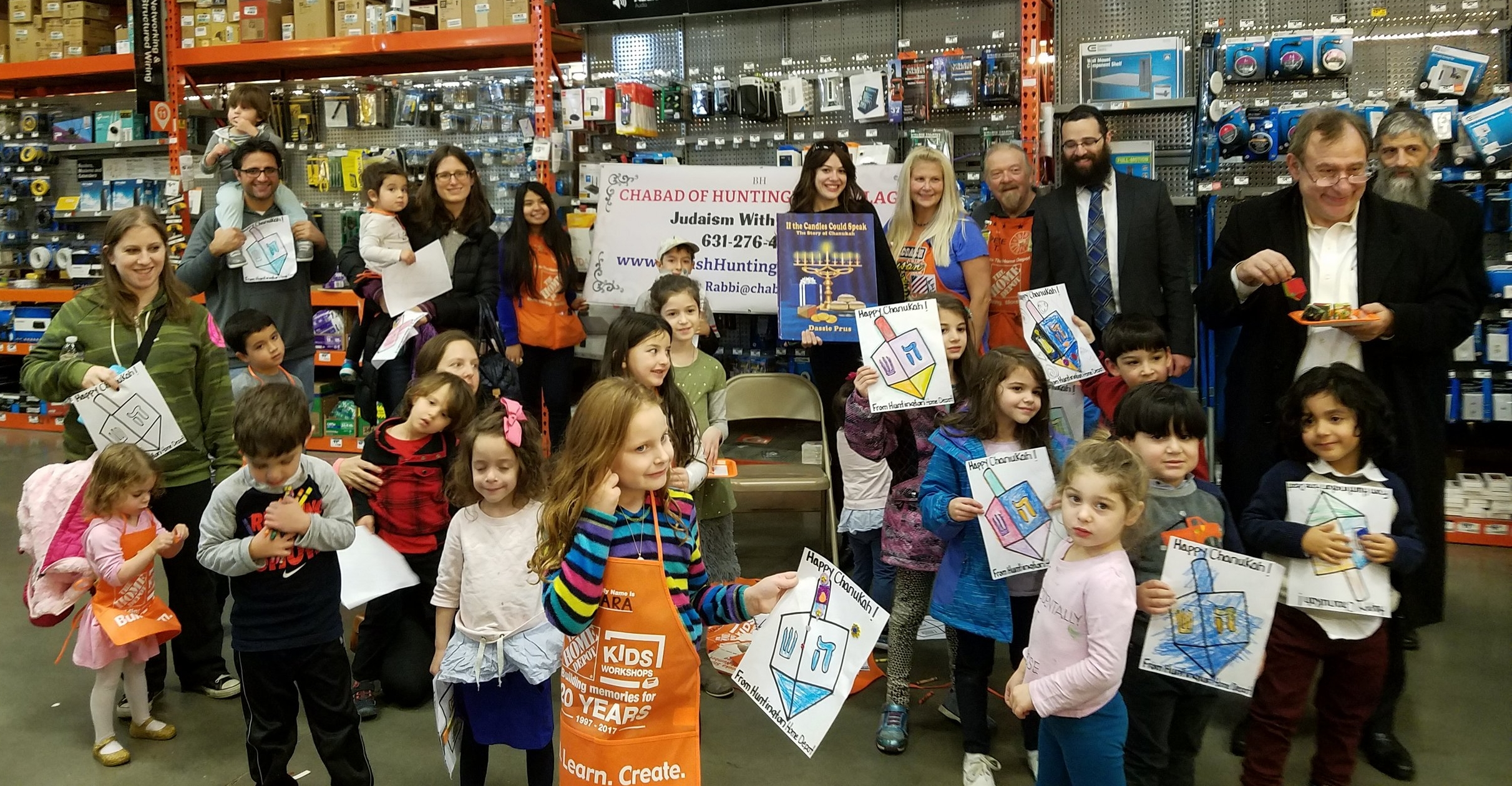 """The crowd at Chabad of Huntington Village's """"Make Your Own Chanukah Dreidel"""" workshop on Sunday.  Photo Courtesy of Chabad of Huntington Village"""