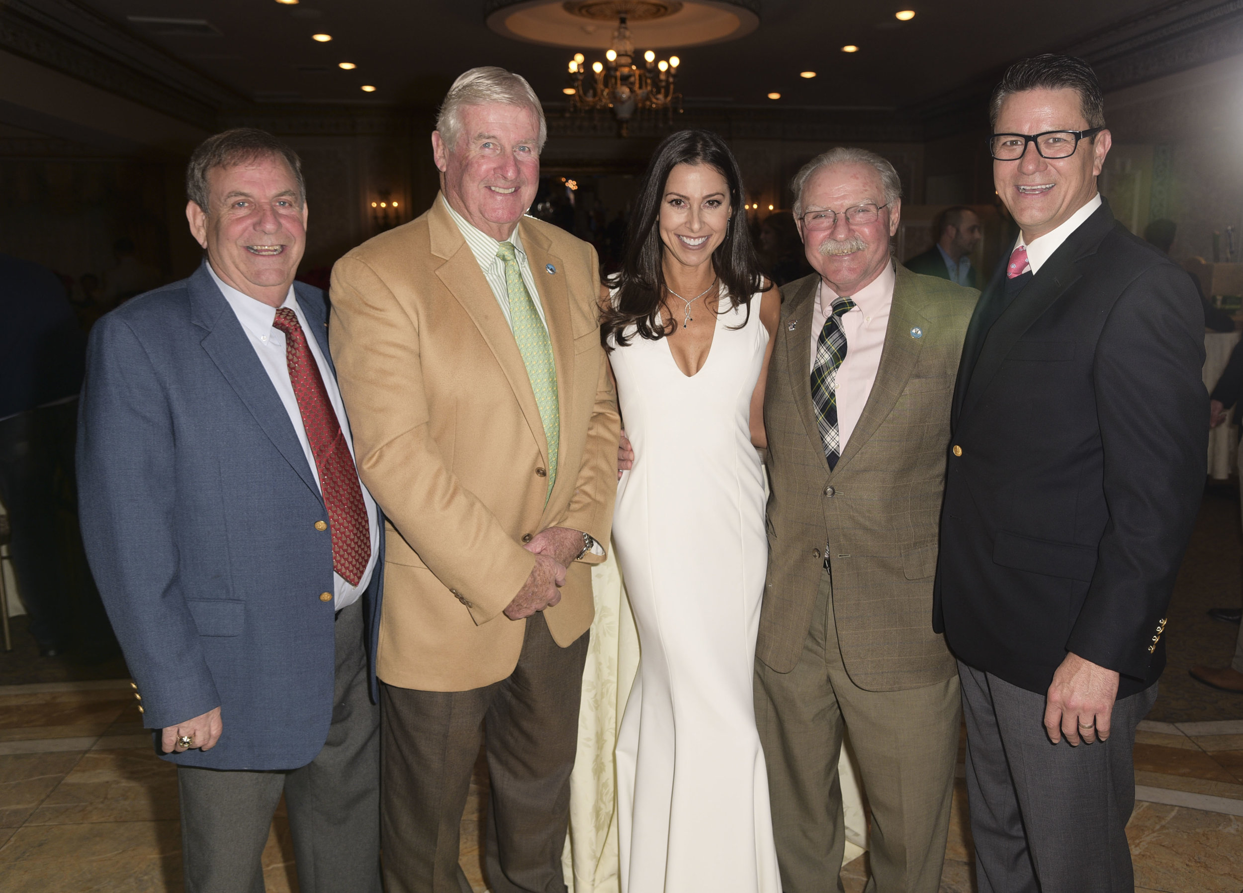 Huntington resident Christine Montanti, third from left, is joined by, from left, Tony Davida, Kevin Muldowney, Ralph Scordino and Steve Neary last week at the eighth annual Holiday Dreams event, which helped raise money to buy gifts for children of families in need.   Photos/Rob Rich/SocietyAllure.com
