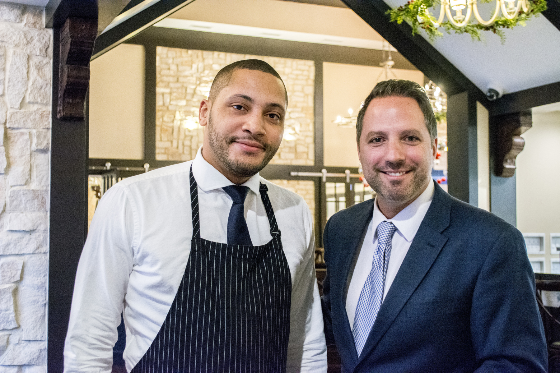 Matteo's Floor Manager Vincent Lorusso, right, exemplifies the friendly and professional service at the recently re-opened Italian restaurant   Long Islander News photos/Barbara Fiore