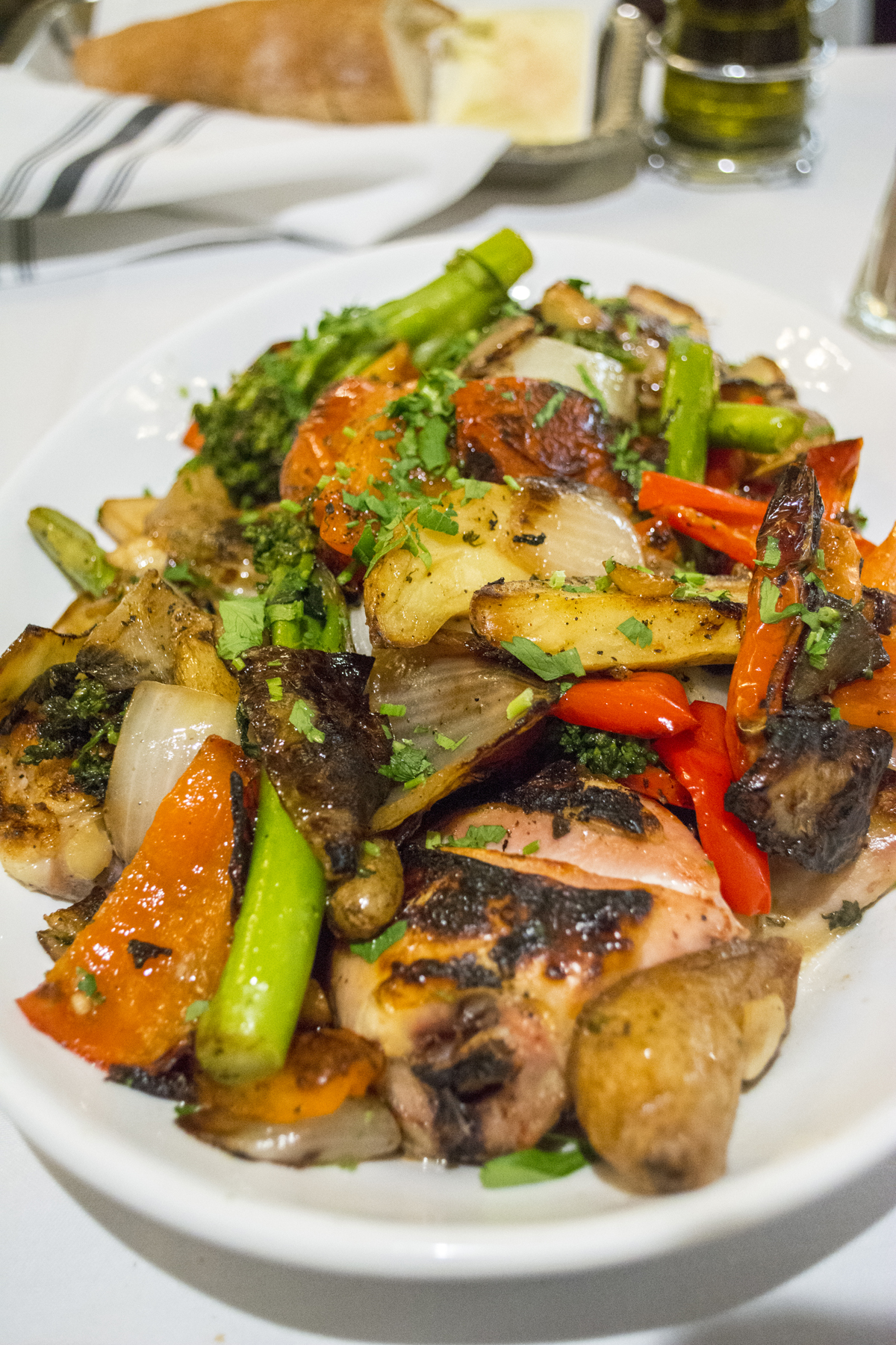 The Chicken Matteo ($26/$39) is served with a heaping portion of sausage, onions, peppers, broccolini and potatoes .  Long Islander News photos/Barbara Fiore