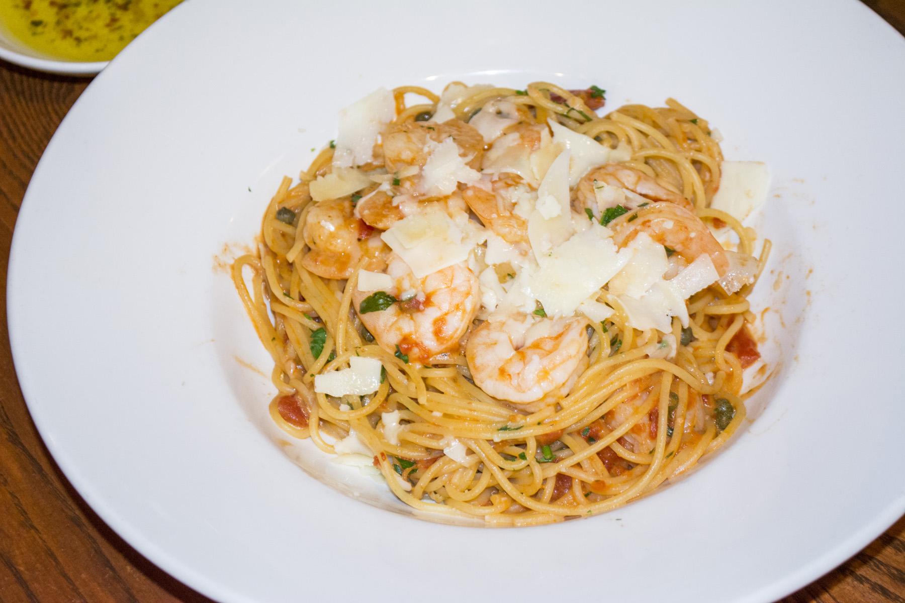 The Shrimp Rossini ($16.99) features sautéed shrimp served over spaghetti in a tomato cream sauce with capers.   Long Islander News photos/Connor Beach