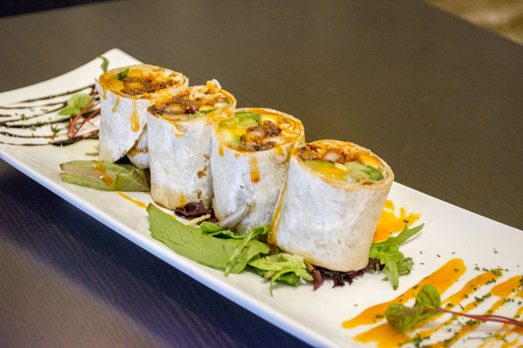 The Duck Roll ($12) features crispy duck wrapped in a tortilla with cucumber, scallion, and apple served with a hoisin sauce.   Long Islander News photos/Connor Beach