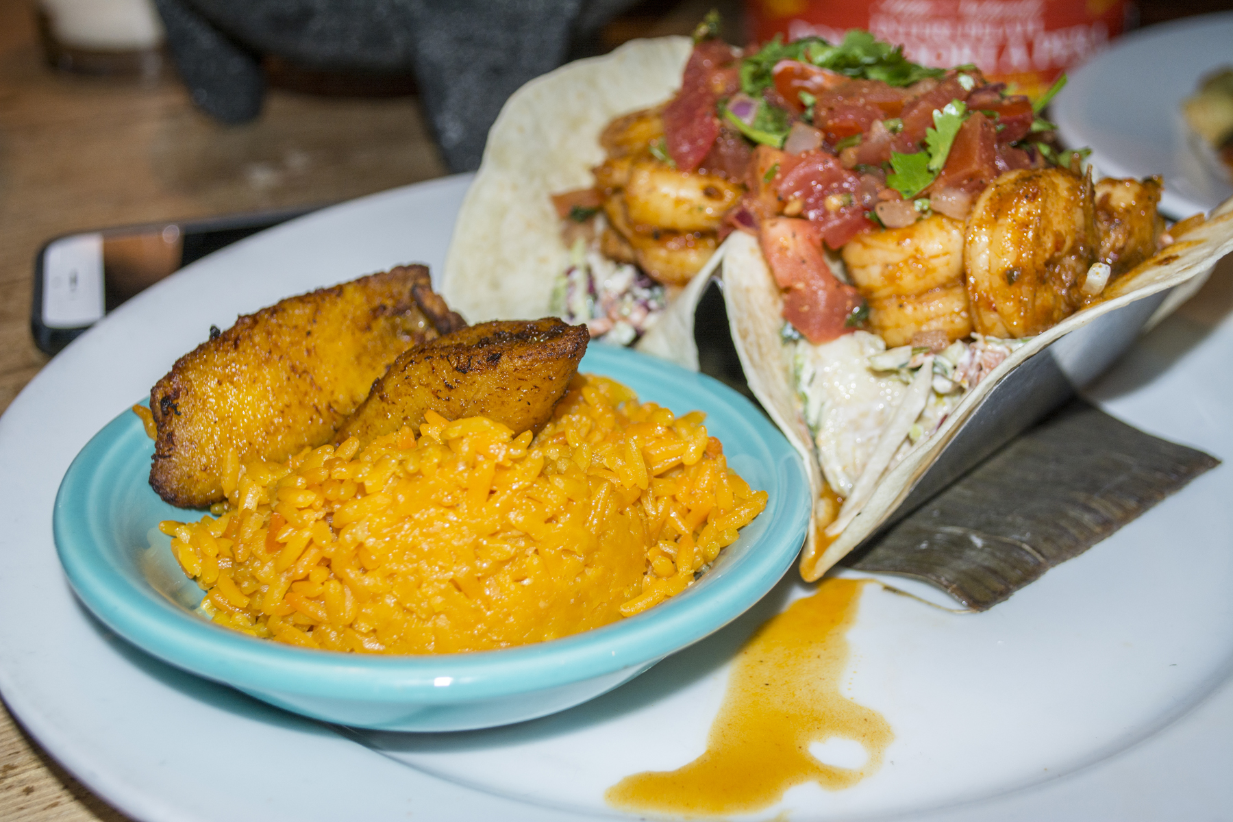 The Angry Shrimp Tacos ($13.95) feature spicy shrimp served with vegetable citrus slaw, lime, margarita crema, Spanish rice and plantains.   Long Islander News photos/Barbara Fiore
