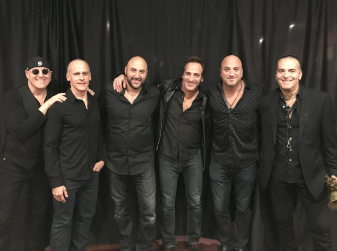 Mike Delguidice, second from right, and his band, Big Shot before a show.   (Photo/Bigshottributeband.com)