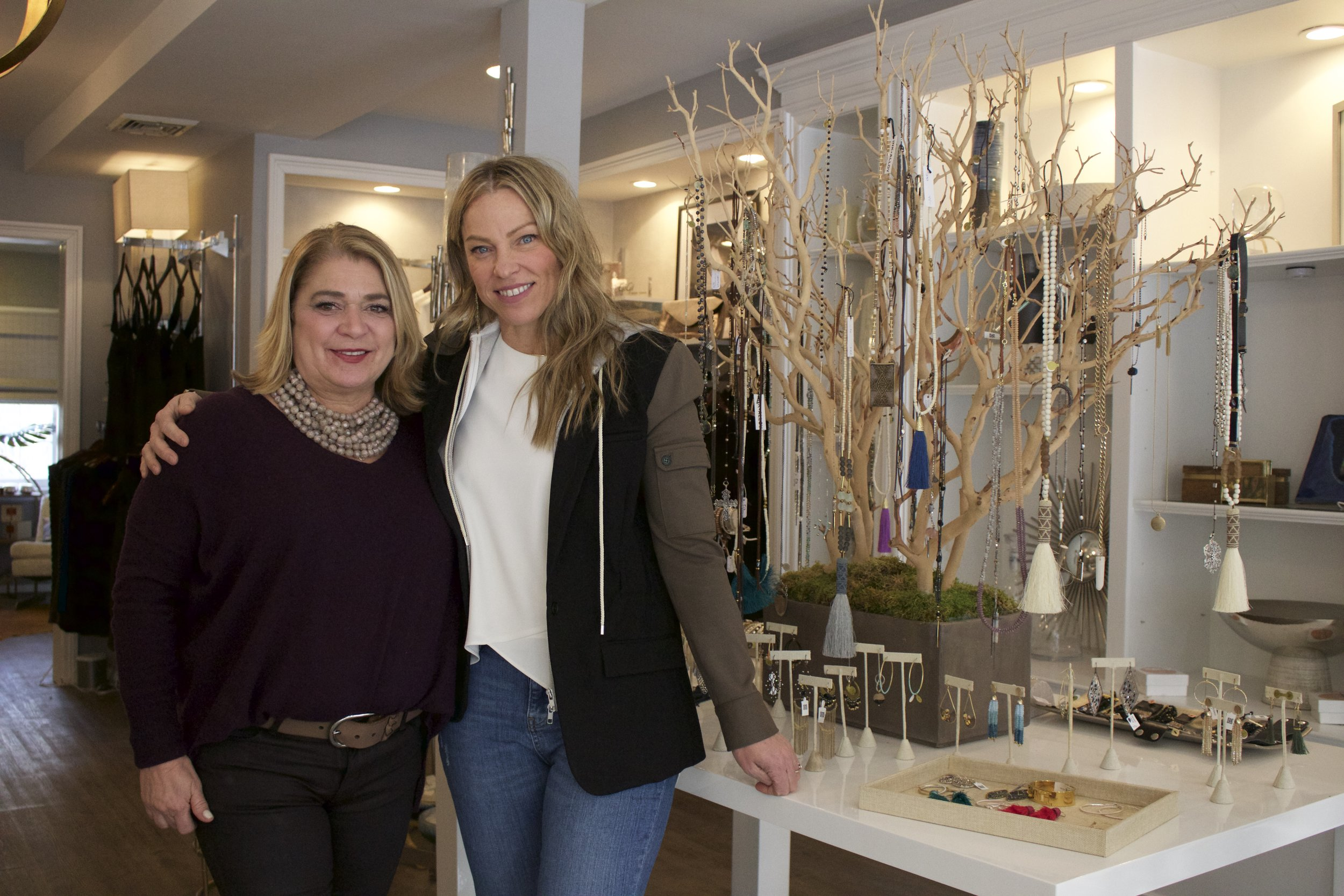 Susan Tamberino and Jenn Cassidy of Living in Cold Spring Harbor stand next to the businesses tree of life.   Long Islander News photos/Janee Law