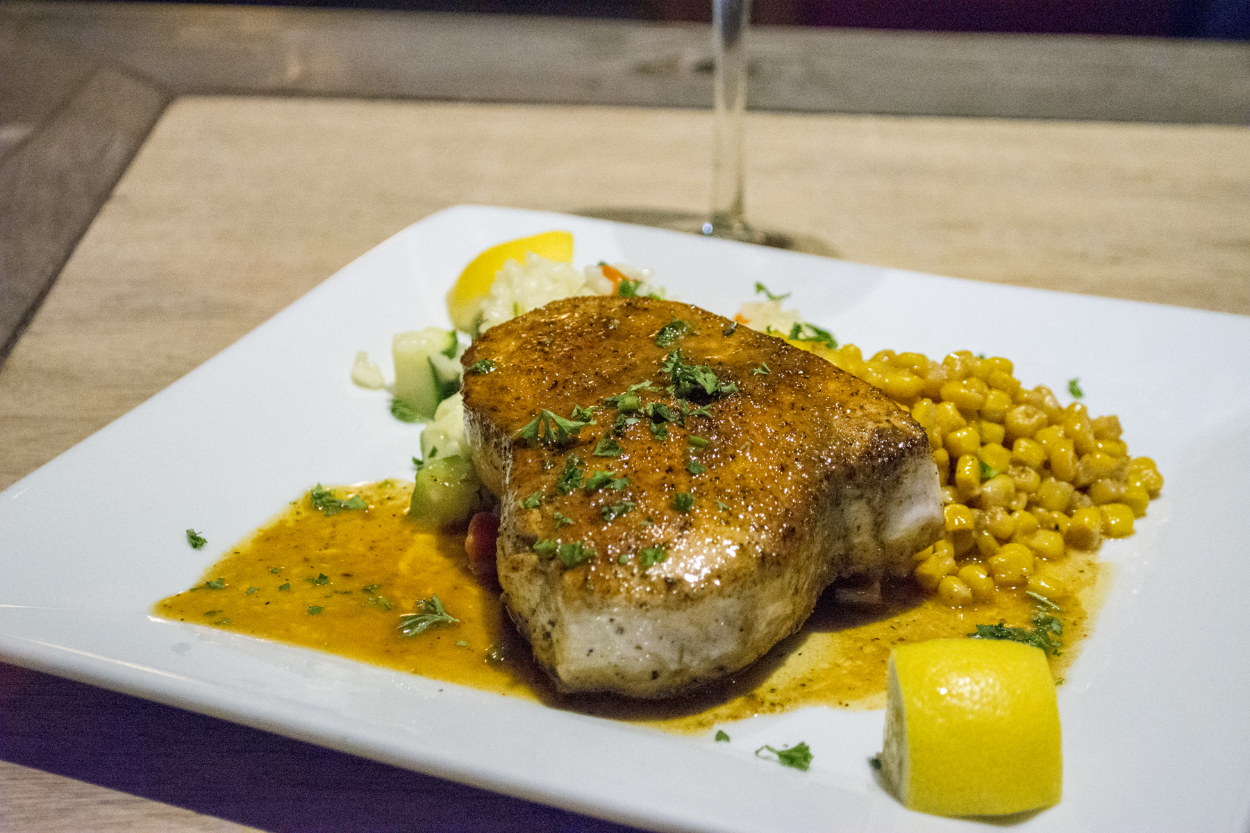 The Blackened Swordfish ($32) is served over vegetable risotto and Caribbean corn.   Long Islander News photos/Barbara Fiore