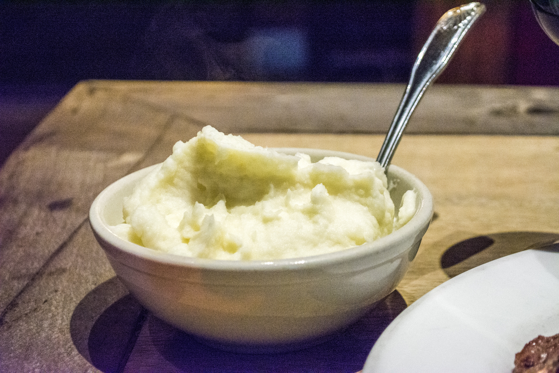 Top inset: The Garlic Mashed Potatoes ($7) are hand peeled and served as a side for any of Mac's steaks.   Long Islander News photos/Barbara Fiore