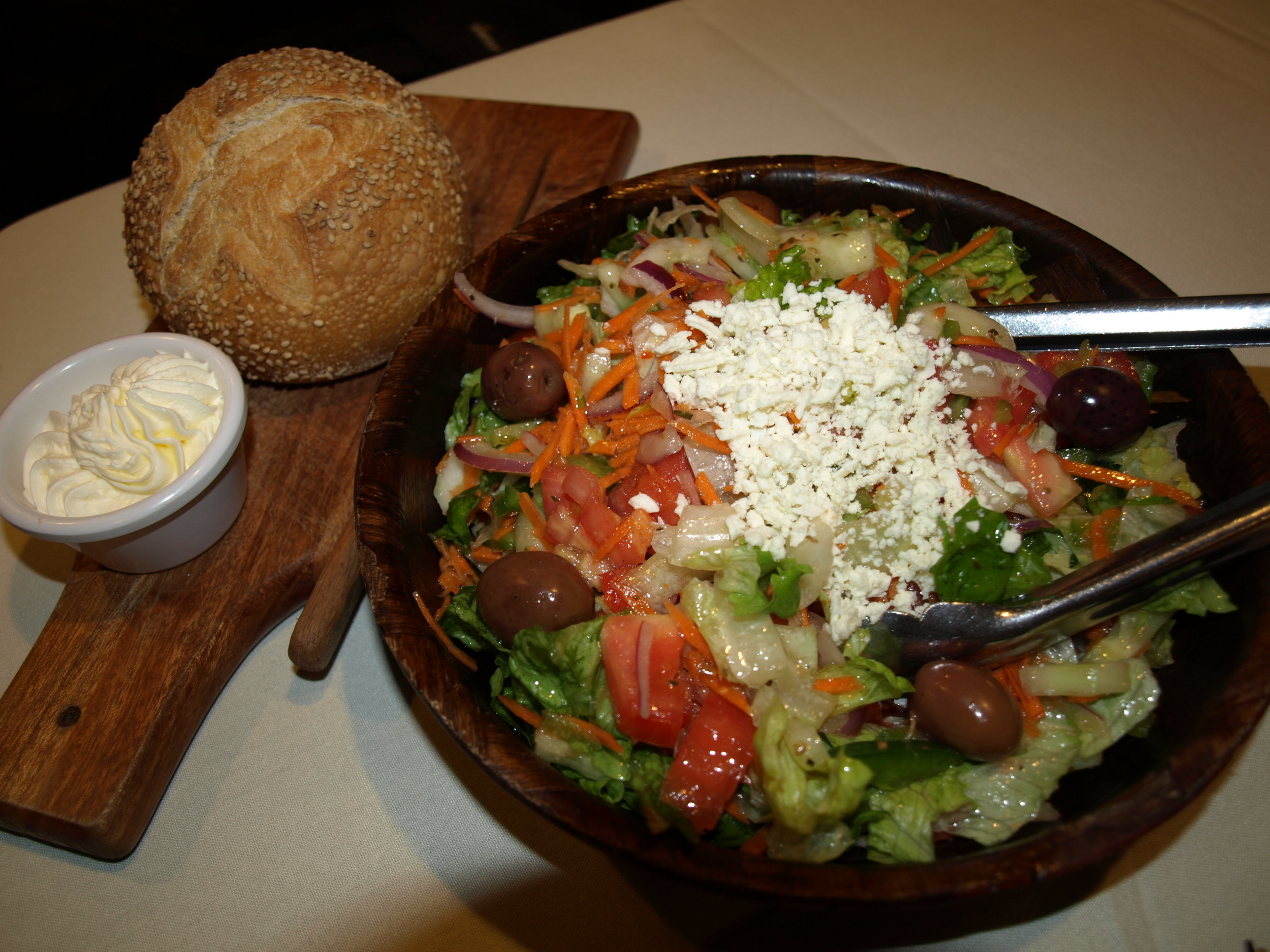 Bonwit's signature Greek Salad ($10) and Bishops Loaf comes with every entrée and is served family style.   Long Islander News photos/Connor Beach