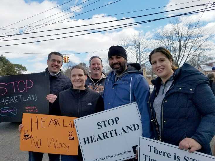 Pictured at the rally against the Heartland Town Square Project are, from left: Justin Marino, board member of 4 Towns Civic Association; Christine Schultz, 4 Towns board member; Richard Loeschner, Brentwood School District superintendent; Robert Feliciano, Brentwood school board president; and Maria Gonzalez-Prescod.   Photo provided by Christine Schultz