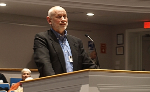 Huntington Township Housing Coalition president Roger Weaving Jr. delivers the 2018 housing report to the town board during Tuesday night's town board meeting.     Long Islander News photo/Connor Beach