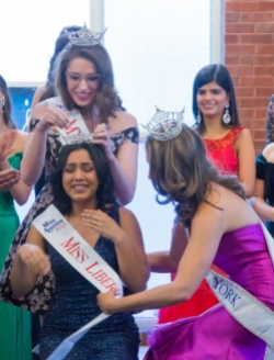 Inpreet Rattu, seated, is crowned Miss Liberty 2018.   Photo courtesy of Paul Klecka
