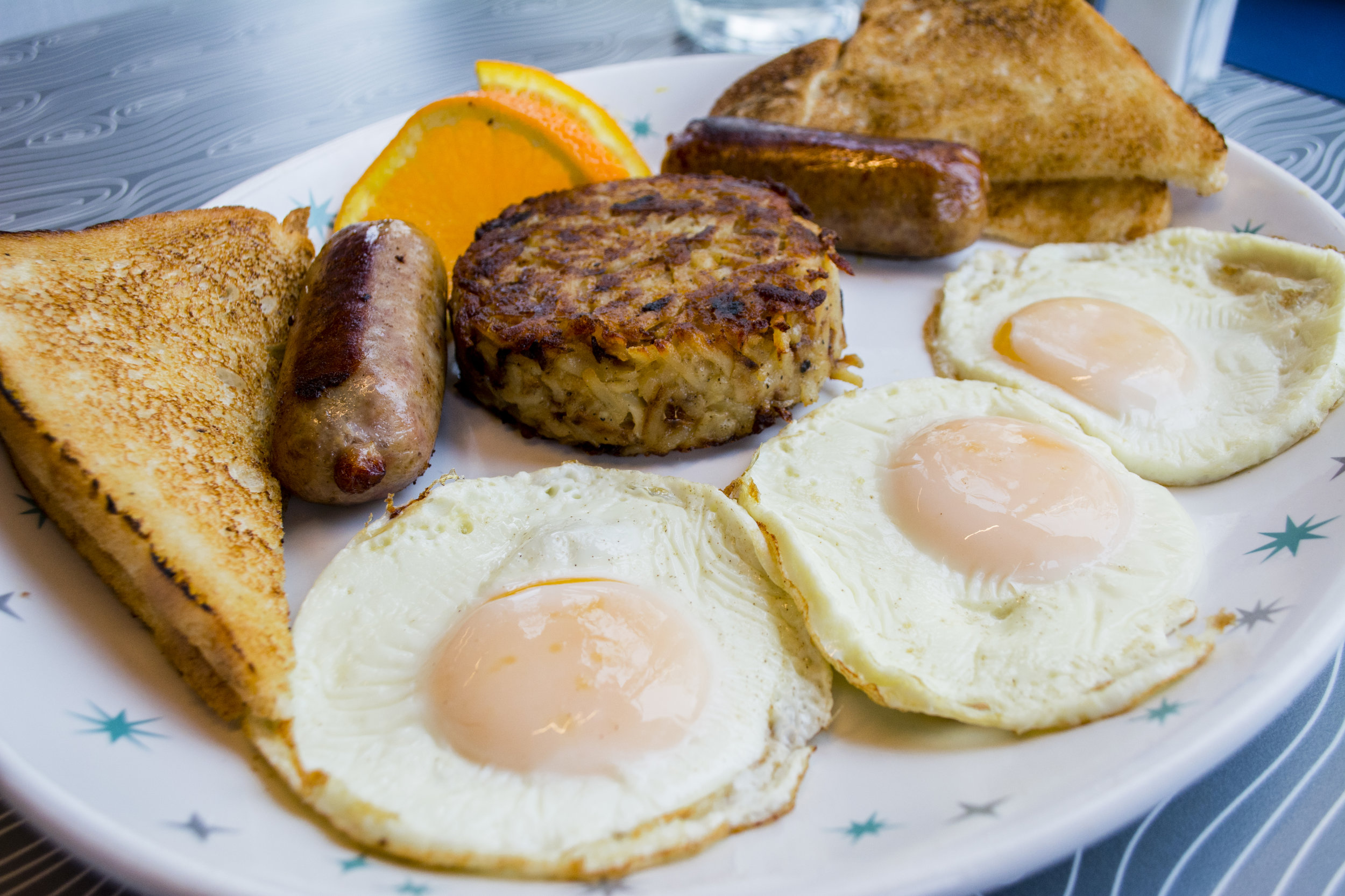 The Classic ($10.75) features three eggs, any style, with a side of hash browns, choice of protein and toast.