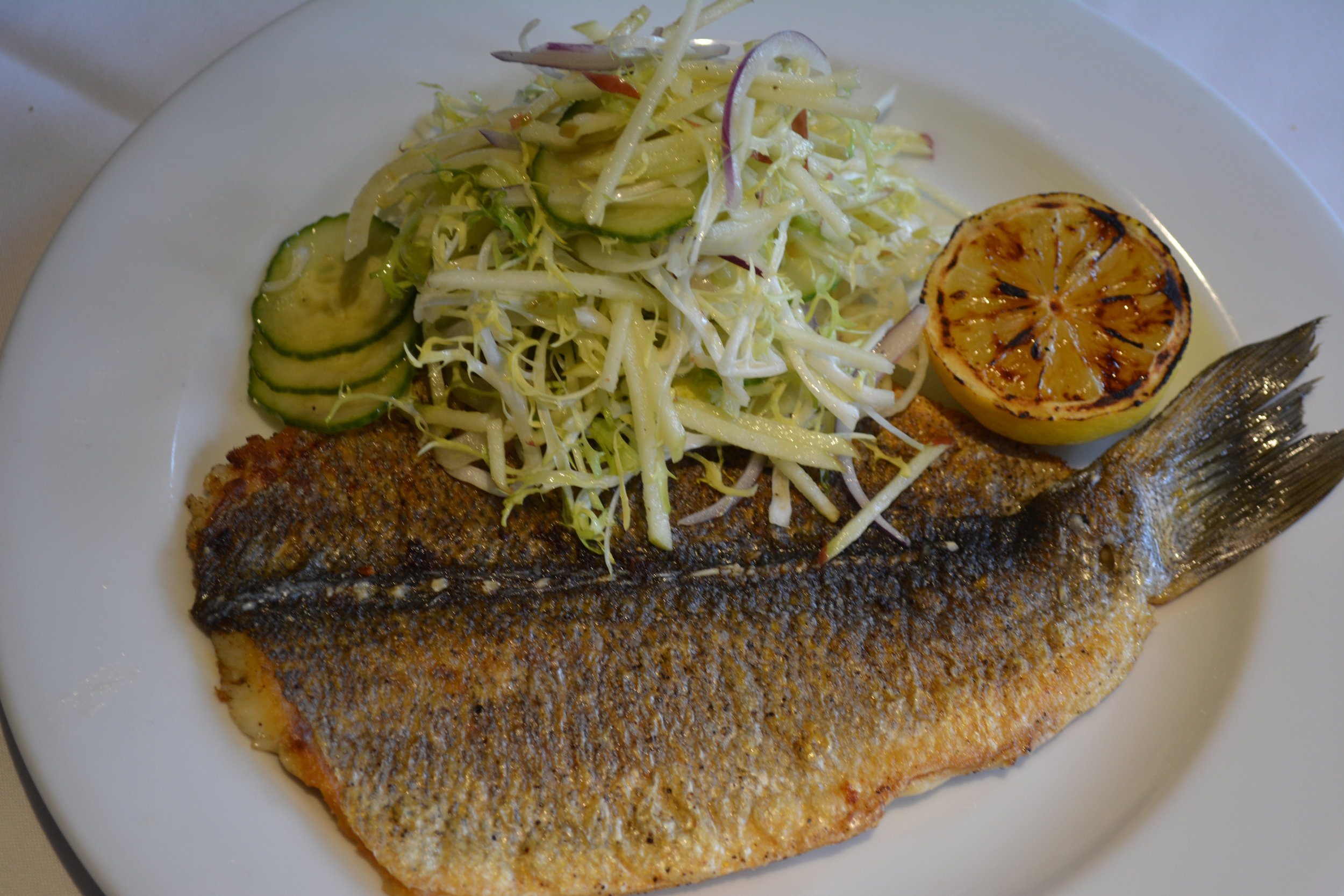The fried whole Branzino with frisee, fennel and apple salad is a new dish for spring.