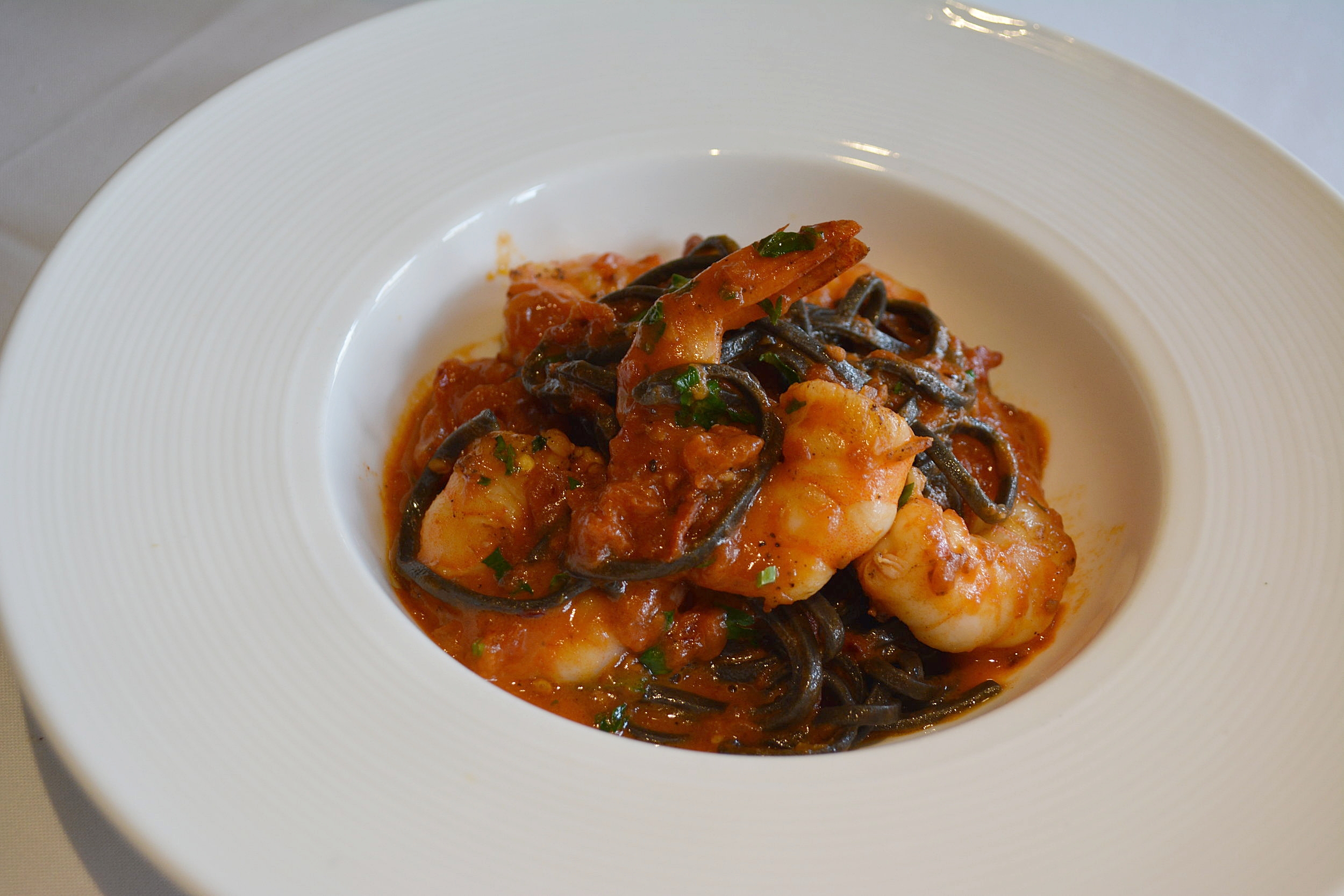 Linguine Nere featuring squid ink linguini, shrimp, and a spicy Marzano tomato sauce, is also new for spring.