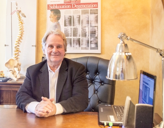 Dr. Michael Posner has 35 years of experience combining his skills as a chiropractor with a variety of other treatment methods to bring relief to patients in Huntington.   (Long Islander News photos/Connor Beach)