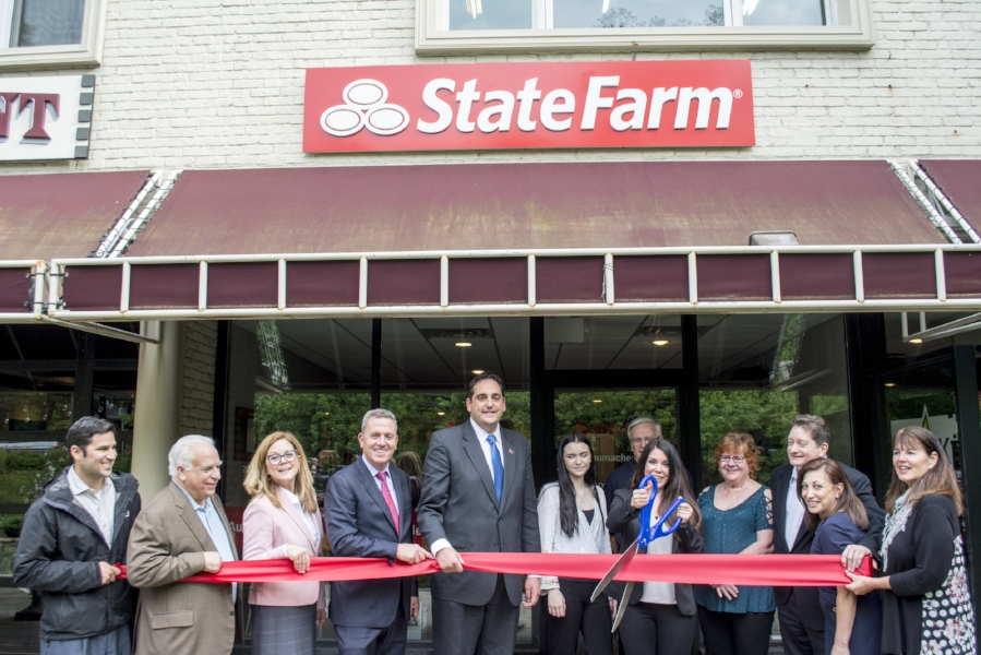 At the ribbon cutting ceremony last week, Huntington Supervisor Chad Lupinacci, left-center, and town council members Joan Cergol and Mark Cuthbertson, second and third from left, are pictured with Huntington Chamber of Commerce board and staff and Kelly Schumacher, pictured center with her team, at her new State Farm Agency in Huntington.
