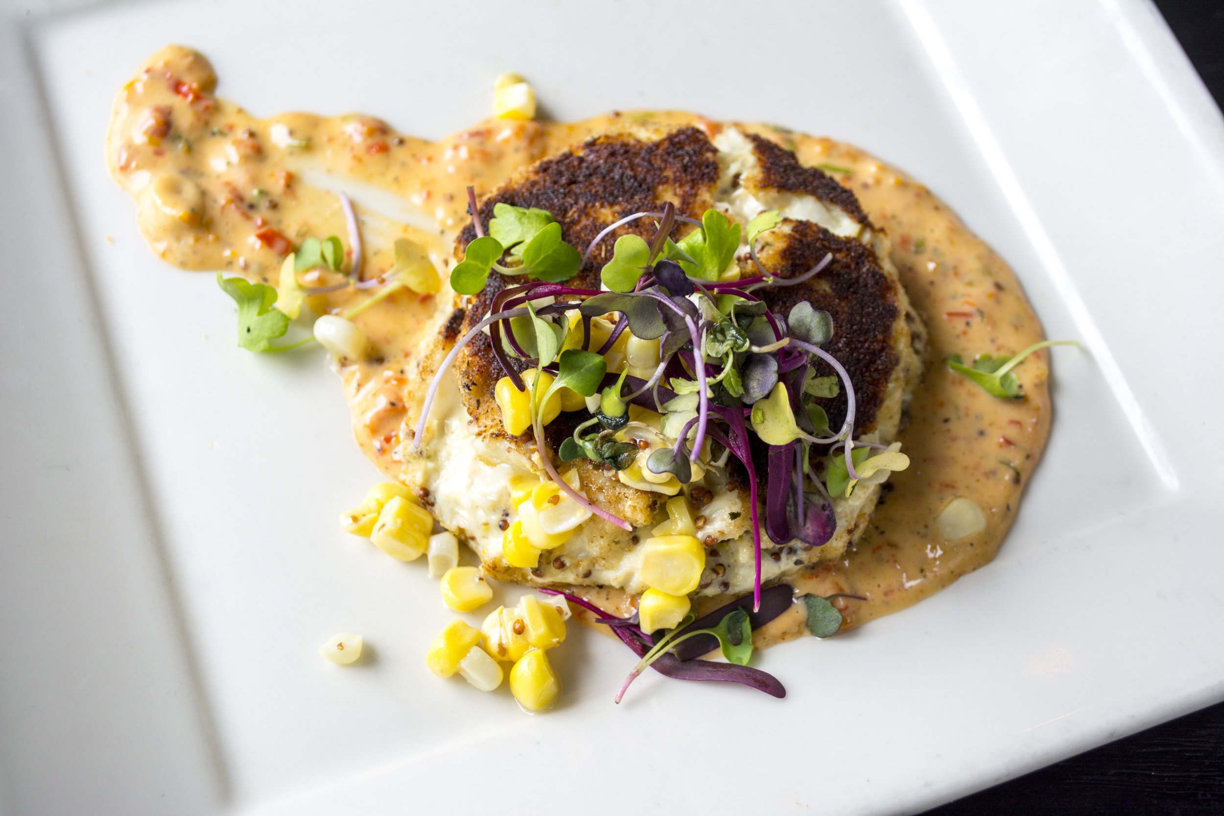 The Crab Cake ($16) includes lump crabmeat, pickled pepper remoulade and roasted corn salad.
