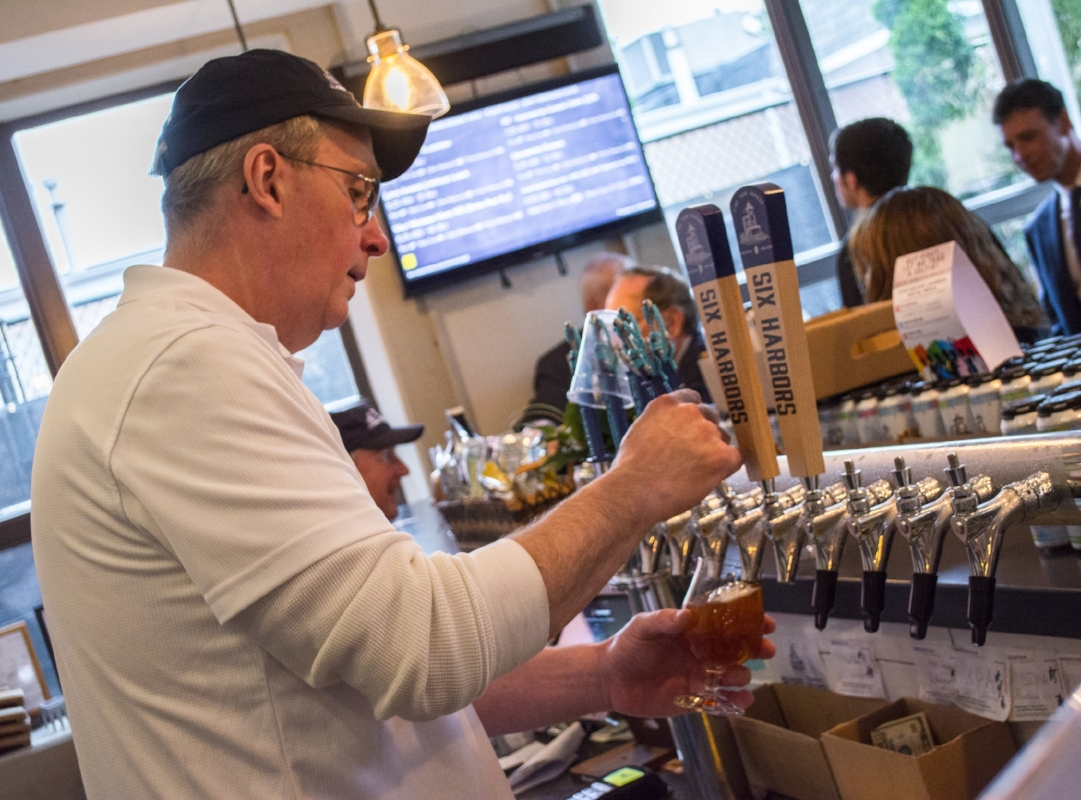 Investor Jim Murray doubles as a bartender in the tasting room.