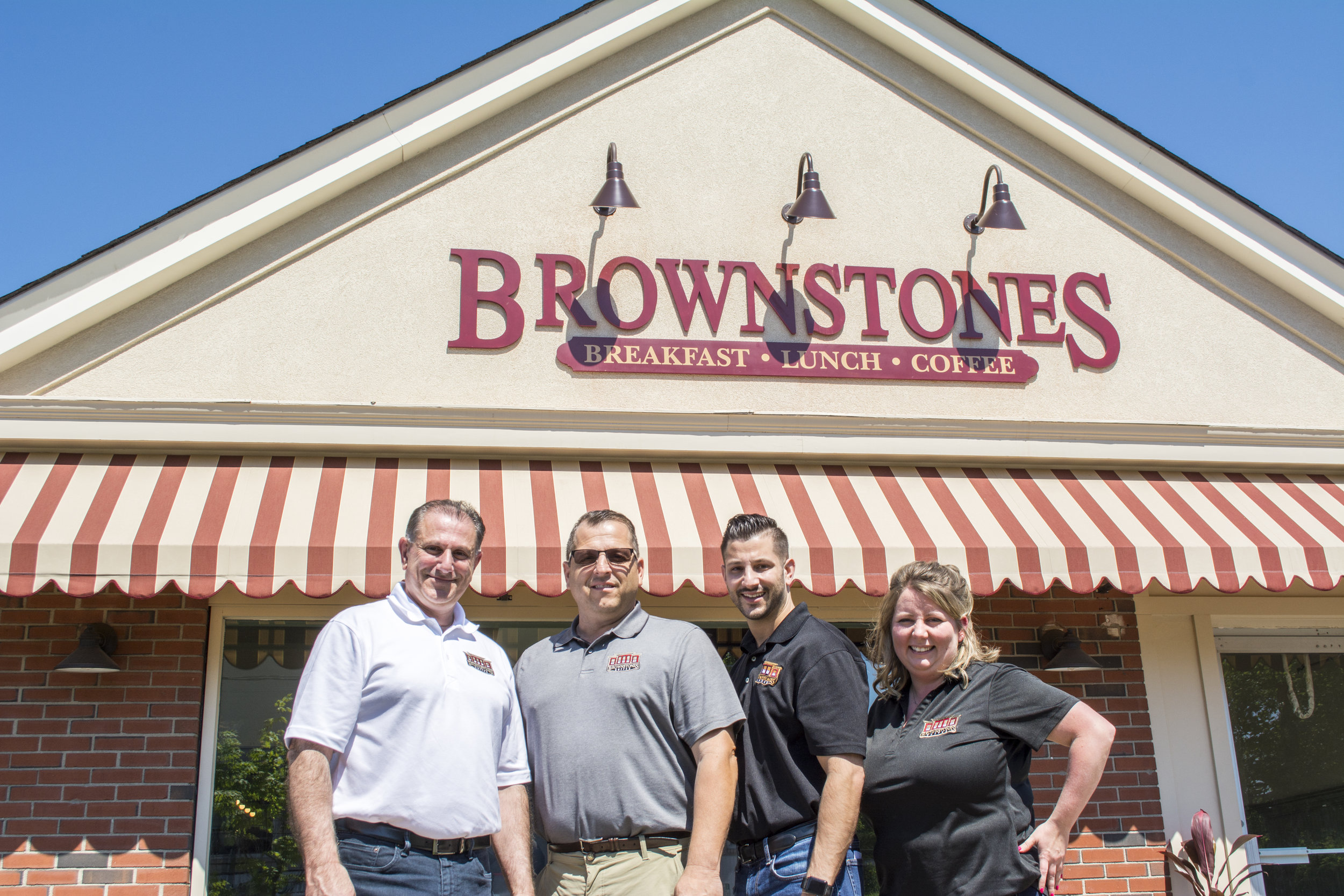 Brownstones partners, from left: Manny Kourounis, John Mangino, Chris Kourounis and Christina Walberg stand outside the local chain's newest location in East Northport.   (Long Islander News photos/Connor Beach)