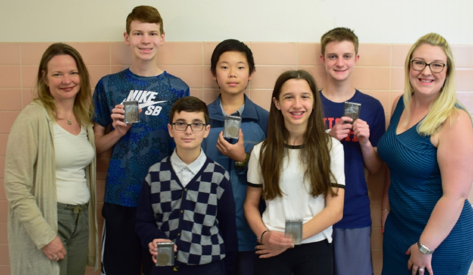 The Oldfield middle schoolers who participated in the Science Olympiad, top and bottom rows, from left: Jacob Costa, Guantian Tao, Chris Costa, Matthew Prietto and Alison Ryan. They're pictured with science teachers Karen Fisher, left, and Brittany Lovett, right.   (Photo/Harborfields schools)
