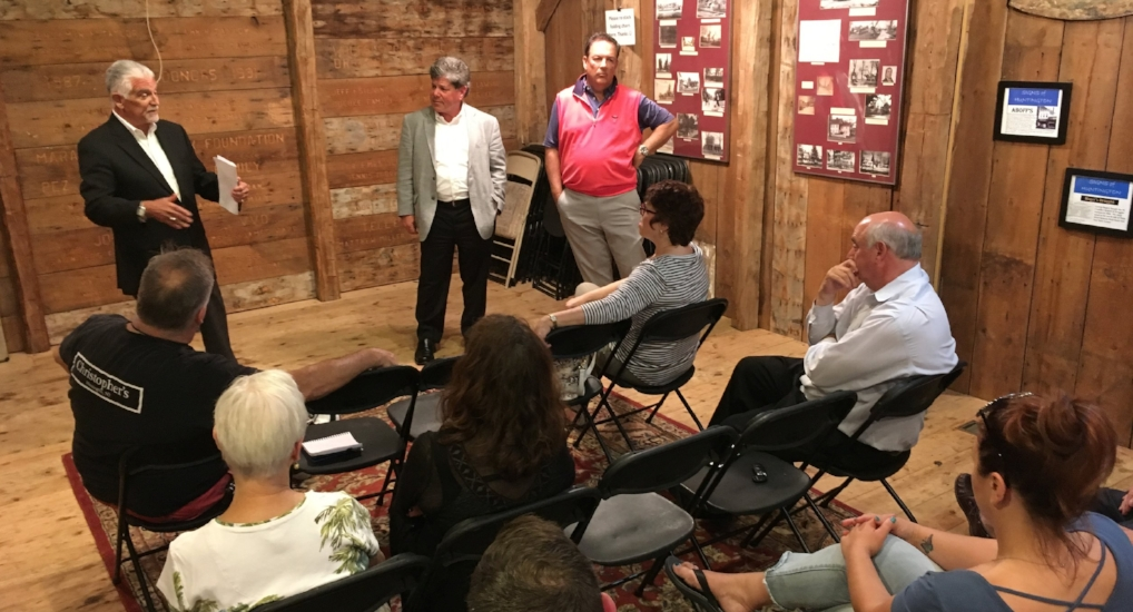 At a meeting of village merchants and business owners earlier this week, Bob Scheiner, David Walsdorf and Dave Panetta, who comprise the steering committee of the Huntington Village Parking Consortium, detail plans for a parking garage.