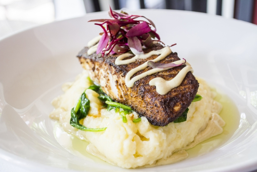 Pan Seared Halibut ($38 or market value) is served with porcini mushroom over sautéed spinach, mashed potatoes and a wasabi aioli.
