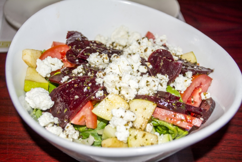 Mykonos Salad ($12) features mixed greens, cucumber, tomato, onion, goat cheese, beets, granny smith apple and candied walnuts.