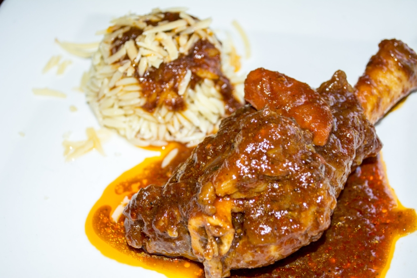 Lamb Shank ($20) is served with a side of orzo and topped with red sauce.