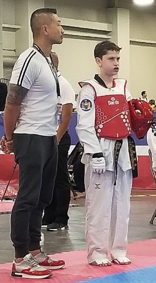 PJ Katcher, right, is pictured at the 2018 USA Taekwondo Nationals held in Salt Lake City earlier this month.   (Photo courtesy of Peter Katcher)