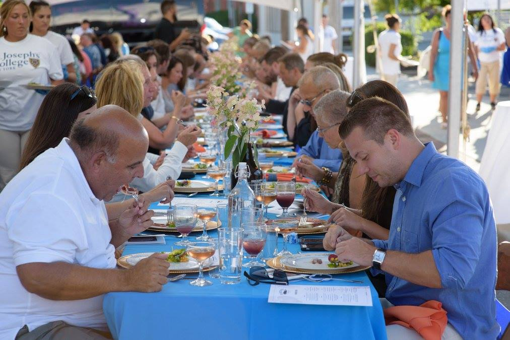 Top chefs prepare a five-course meal that celebrates Long Island's bounty at the Island To Table outdoor dining experience.   (Photo: Greater Patchogue Chamber of Commerce)