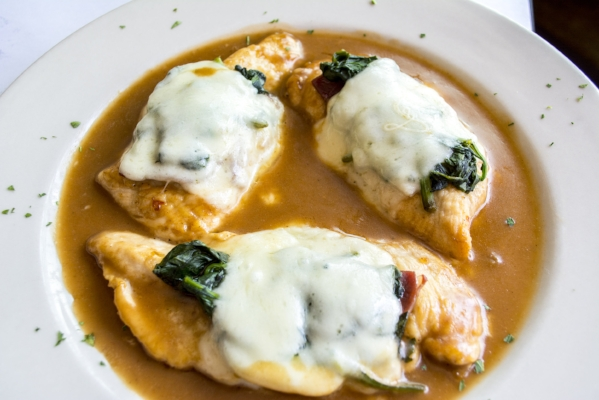 Chicken Florentine ($22/$29) features chicken topped with spinach, prosciutto and mozzarella served with a sherry sauce.
