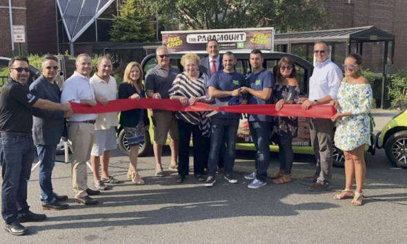 Town officials and business representatives cut the ribbon to officially launch the Qwik Ride service in Huntington Village last Friday.    Photo/Michelle Martines