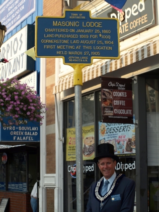Worshipful Master, Richard Harris celebrating the placement of a historical marker in front of the Masonic Lodge in Huntington.   Long Islander photo/Sophia Ricco