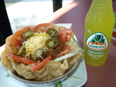 Tex-Mex Tostada Salad ($9.21), featuring ground beef served in a crisp flour tortilla with lettuce, jalapenos, tomato, salsa ranchera and a mix of cheeses, taste great with a Jarritos ($2.00), a popular Mexican soda.