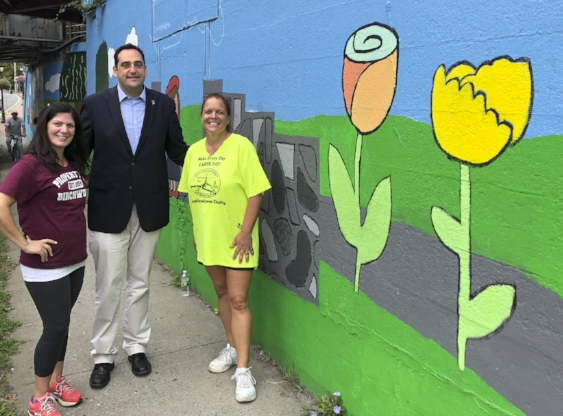 At the new mural, from left, are former assistant principal at Birchwood Intermediate School Annie Michaelian, Huntington Supervisor Chad Lupinacci and Birchwood teacher Barbara Wright.