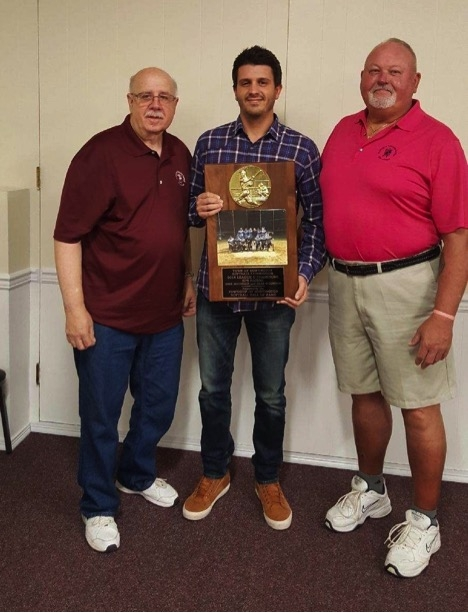 Huntington Softball Hall of Fame President James Coschignano Jr., left, and Vice President Clint Riggs, right, present SPS Nation sponsor and player Mike Ruconich, center, with a plaque for winning Division 2 in the Town of Huntington recreation softball league.