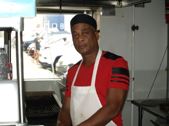Chef DelRoy Watson, top right, is cooking family recipes of traditional Jamaican fare at Mobay Breeze in Huntington village.  Long Islander News photos/Connor Beach
