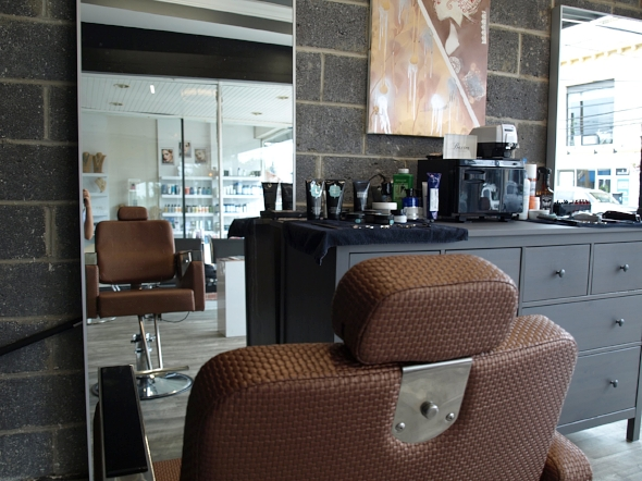 The Men's Shop has a masculine feel with exposed masonry walls, grey accents and new leather and steel barber chairs.