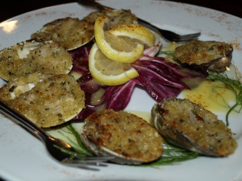 Start your meal with Baked Clams Oreganata, on the DineHuntington Restaurant Week menu at Black & Blue Seafood Chophouse.