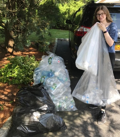 Half Hollow Hills High School East senior Janna Zilka collects and redeems bottles and donates the proceeds to charity.