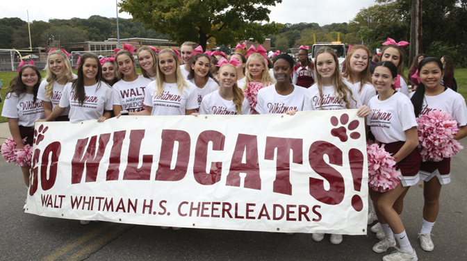 The Walt Whitman Cheerleaders ready to root for the home team after marching in the parade.  Photos/Spouth Huntington School District
