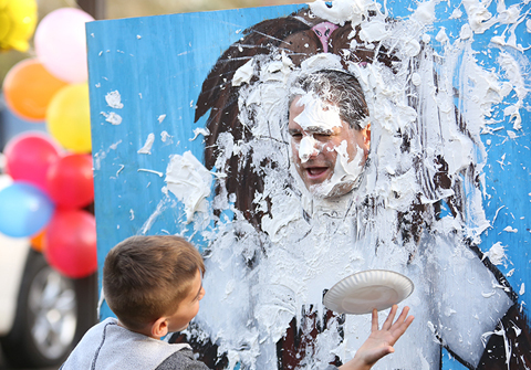 Birchwood Principal Anthony Ciccarelli gets a face full of whipped cream at the homecoming festival.